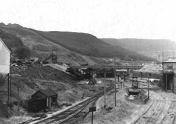 Ffaldau Colliery in 1986 in the early stages of demolition. You can see the railwayman's hut in the foreground and the weighbridge in the distance.