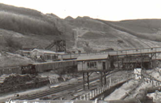Ffaldau Colliery in 1986 in the early stages of demolition. This shows the weighbridge in the foreground and the walkway where the men came up from the pit and went into the pithead baths.