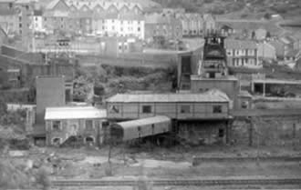 Ffaldau Colliery in 1986 during demolition. You can see the head frame on the right.