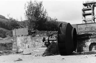 Ffaldau Colliery in 1986 during demolition. This is the ventilating fan, it was 16 to 18 feet in diameter. It was due to be moved to St. John's Colliery in Maesteg but it was too big to get under the bridges between Ffaldau and Maesteg.