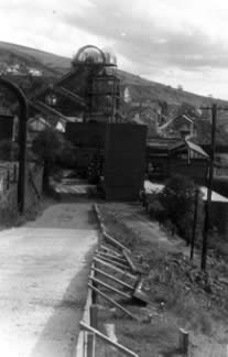 Ffaldau Colliery in 1986 during demolition. They were apparently still painting the head frame whilst it was closing; they had to, they'd signed a contract.