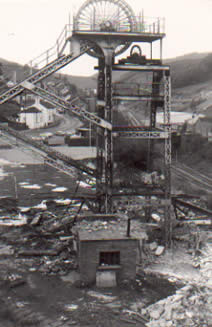 Ffaldau Colliery in 1986 during demolition. The small wheel just below the large wheel was used in an emergency to bring the men up the shaft.