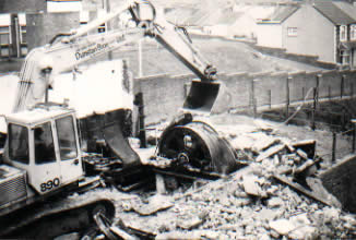 Ffaldau Colliery winding house demolition 1985. The remains of the 'upcast shaft' winding gear.