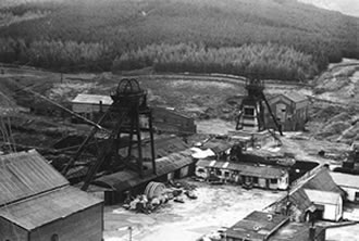 Caerau Colliery 1979. The spare sheave wheel (in 2 halves) which can be seen in the courtyard here, were sent to St. John's Colliery when Caerau closed down but they were never used as St. John's closed down not long after. The sheave wheel was eventually donated to the South Wales Miners Museum by the National Coal Board and is now on display there.