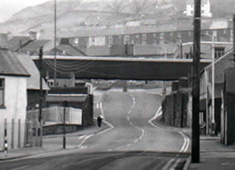 Bridge Street in Blaengarw. This is the conveyor housing from the Garw Colliery crossing the street. Once upon a time trains crossed here.