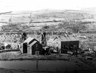 Coegnant Colliery 1981. When they demolished the head frame it collapsed on top of the winding house.