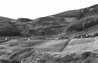 The Garw Valley after the closure of the pits and before reclamation of the area began. The reclamation process took 20 years to instigate but is now complete. All the slag heaps and spoil have been removed and the valley is green again.