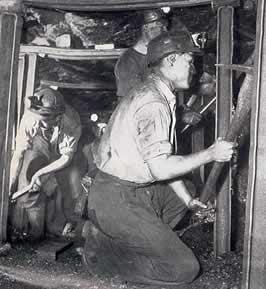 Men working below ground at Ffaldau Colliery in 1955.